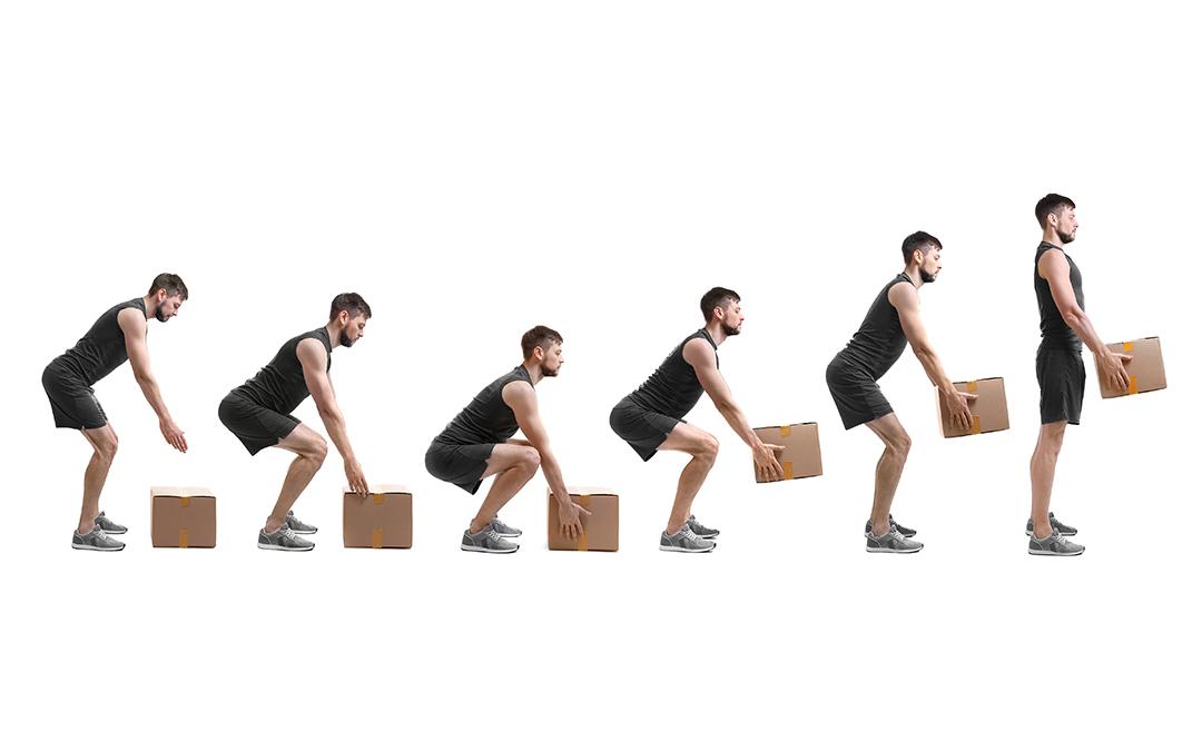 Sollevare un peso: schiena dritta o schiena flessa?